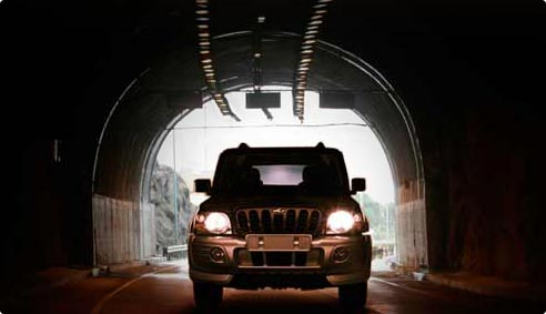 Mahindra Scorpio in the tunnel with headlamps on