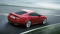 Jaguar XKR Coupé in Italian Racing Red Color Exterior Right Side Back Top View Wallpaper