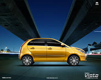 Tata Indica Vista Wallpaper Summer Sparkle Yellow Color Right Side View
