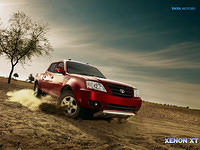 Tata Xenon XT on sandy roads in Mineral Red Color Right Side Front View Wallpaper